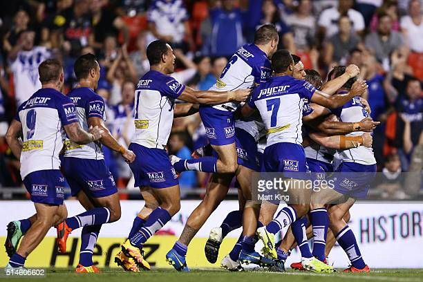 Kerrod Holland of the Bulldogs celebrates with team mates after kicking a conversion to win the game during the round two NRL match between the...