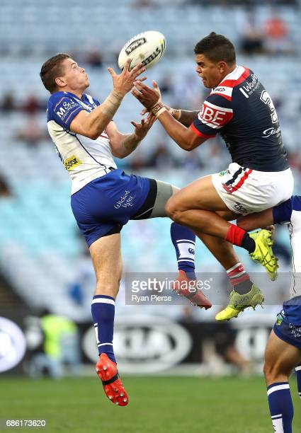 Kerrod Holland of the Bulldogs is penalised by Latrell Mitchell of the Roosters during the round 11 NRL match between the Canterbury Bulldogs and the...