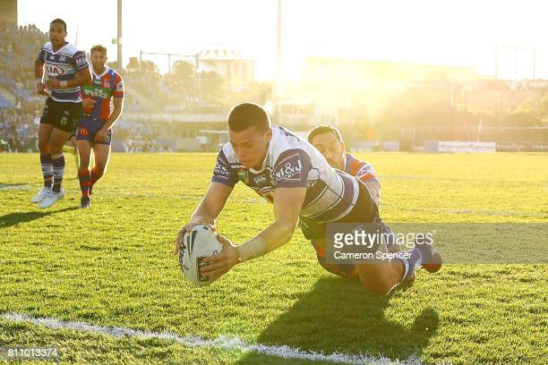 Kerrod Holland of the Bulldogs scores a try during the round 18 NRL match between the Canterbury Bulldogs and the Newcastle Knights at Belmore Sports...