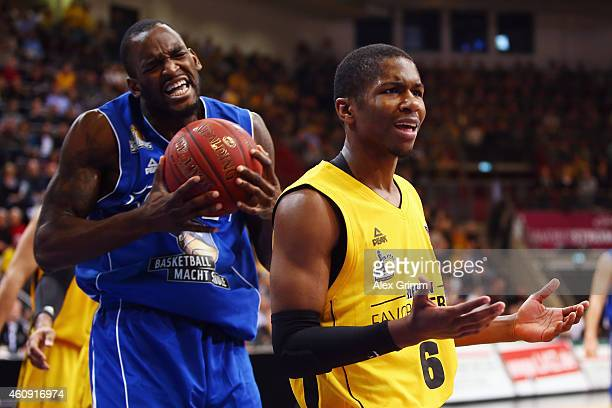 Kerron Johnson of Ludwigsburg and Mike Morrison of Frankfurt react during the Beko BBL basketball match between MHP Riesen Ludwigsburg and Fraport...