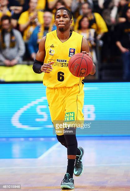 Kerron Johnson of Ludwigsburg controles the ball during the Beko BBL basketball match between MHP Riesen Ludwigsburg and Fraport Skyliners at MHP...