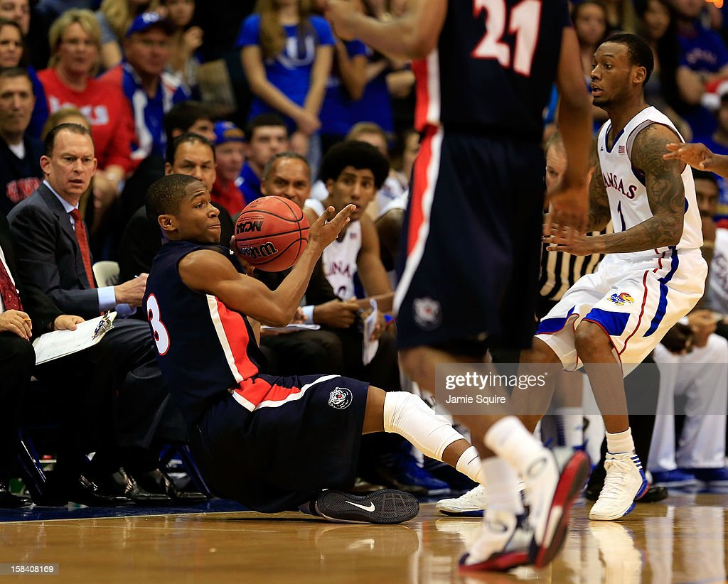Kerron Johnson #3 of the Belmont Bruins grabs a loose ball as Naadir Tharpe #1 of the Kansas Jayhawks defends during the game at Allen Fieldhouse on December 15, 2012 in Lawrence, Kansas.