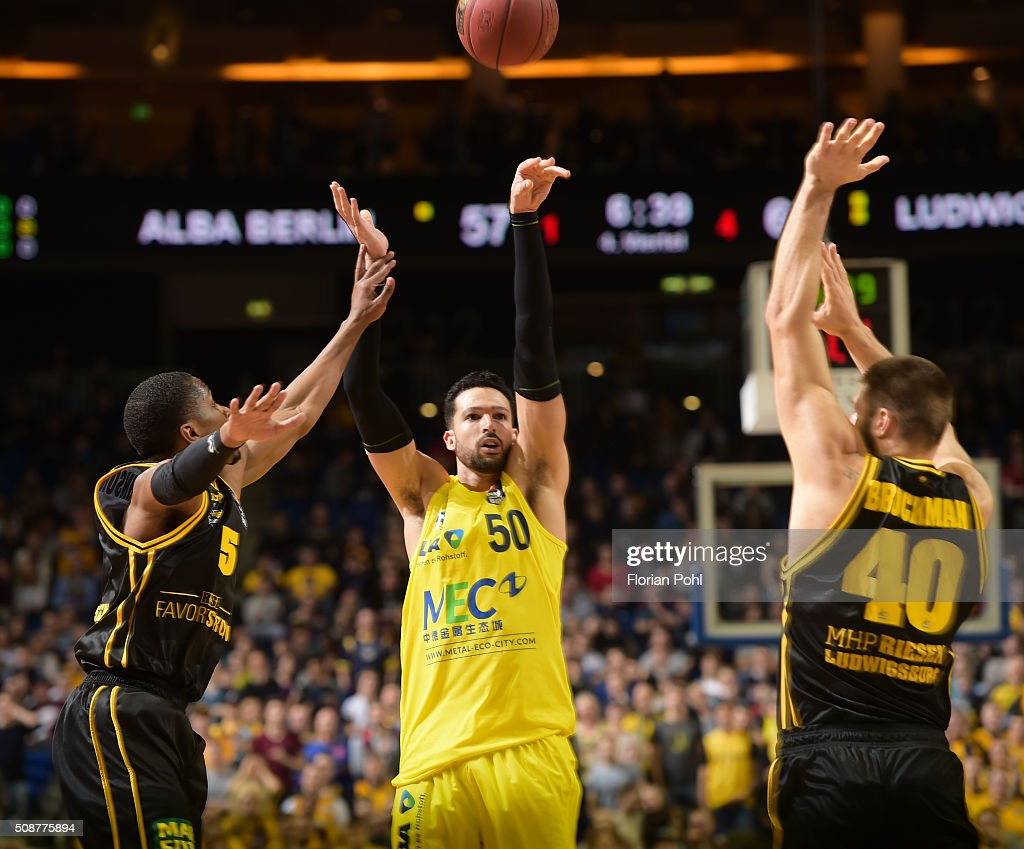 Kerron Johnson of the MHP Riesen Ludwigsburg, Mitchell Watt of ALBA Berlin and <a gi-track='captionPersonalityLinkClicked' href=/galleries/search?phrase=Jon+Brockman&family=editorial&specificpeople=835312 ng-click='$event.stopPropagation()'>Jon Brockman</a> of the MHP Riesen Ludwigsburg during the game between Alba Berlin and the MHP Riesen Ludwigsburg on february 6, 2016 in Berlin, Germany.