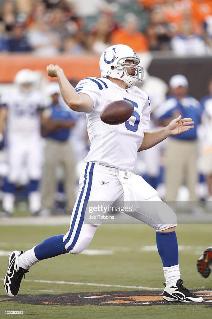 Kerry Collins #5 of the Indianapolis Colts has the football knocked out of his hand while trying to pass in the first half of an NFL preseason game against the Cincinnati Bengals at Paul Brown Stadium on September 1, 2011 in Cincinnati, Ohio.