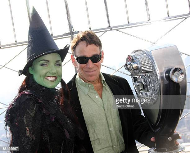 Kerry Ellis as 'Elphaba' and Composer Stephen Schwartz pose at the lighting of the Empire State Building wicked green for the 5th anniversary of...
