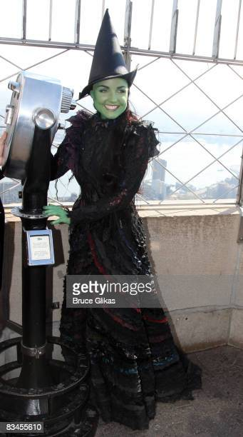 Kerry Ellis as 'Elphaba' poses at the lighting of the Empire State Building wicked green for the 5th anniversary of 'Wicked' on Broadway on October...