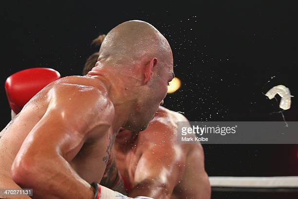 Kerry Foley's mouth guard flies out after he was punched in his fight against Robert Berridge during the Light Heavyweight bout between Kerry Foley...