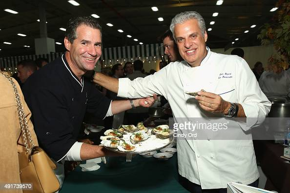 Kerry Heffernan of Grand Banks and Chef Eric Ripert attend City Harvest's 21st Annual Bid Against Hunger at Pier 36 on October 7 2015 in New York City
