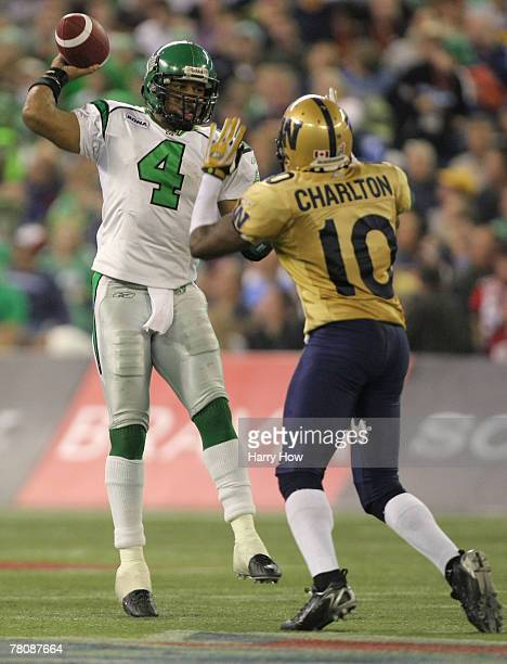 Kerry Joseph of the Saskatchewan Rough Riders scrambles as he passes over Ike Charlton of the Winnipeg Blue Bombers during the third quarter of the...