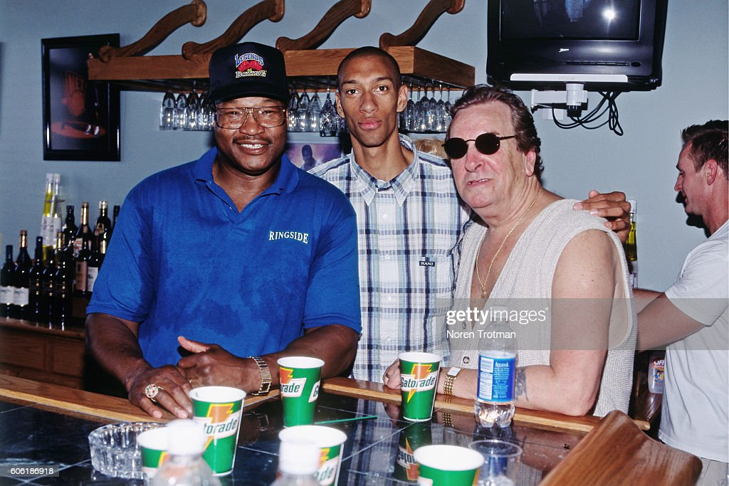 Kerry Kittles #30 of the New Jersey Nets poses for a photo with actor, Danny Aiello and boxer, Larry Holmes during a Jayson Williams All-Star BBQ event in East Rutherford, New Jersey on June 27, 1999.