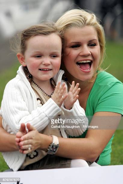 Kerry McFadden winner of reality television show 'I'm a Celebrity Get Me Out Of Here' with Amy Campbell 5 from St Josephs Primary School as the Queen...