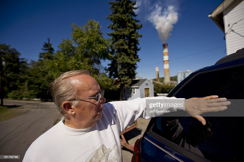 Kerry VanKirk, 68, laments about the amount of flyash that comes from the exhaust stack of the Mitchell Power Station, a coal-fired power plant built along the Monongahela River, 20 miles southwest of Pittsburgh, on September 24, 2013 in New Eagle, Pennsylvania. The plant, owned by FirstEnergy, will be one of two plants in the region to be shut down, affecting 380 employees. The Evironmental Protection Agency (EPA) and the Obama administration have been taking major steps to get coal-fired power plants into compliance with clean air regulations.