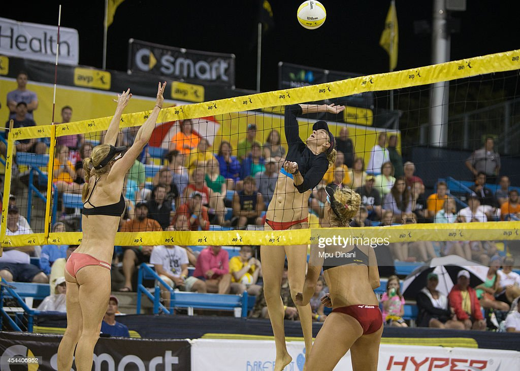 Kerry Walsh-Jennings (M) jumps to spike the ball against Kim DiCello (L) as April Ross (R) looks on at the 2014 AVP Cincinnati Open on August 30, 2014 at the Lindner Family Tennis Center in Cincinnati, Ohio.