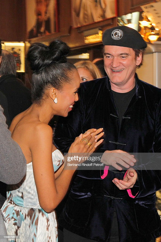 Kerry Washington and Quentin Tarantino share a light moment prior to attending a photocall for 'Django Unchained' at Le Grand Rex on January 7, 2013 in Paris, France.