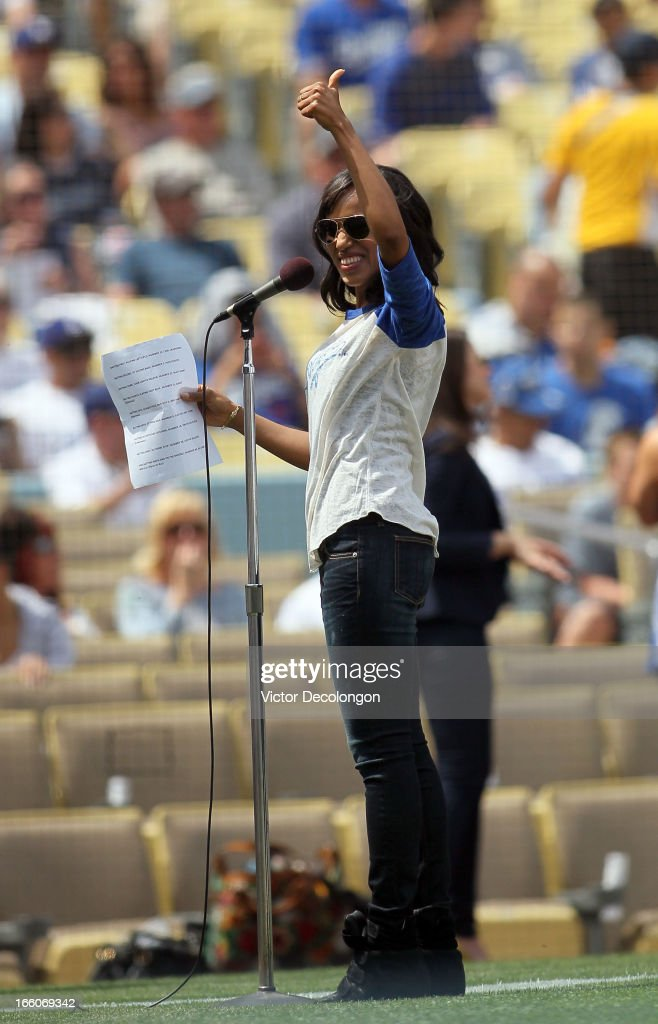 Kerry Washington, from the television show 'Scandal' gives a thumbs up prior to announching the starting line up for Los Angeles Dodgers before the MLB game between the Pittsburgh Pirates and the Los Angeles Dodgers at Dodger Stadium on April 7, 2013 in Los Angeles, California. The Dodgers defeated the Pirates 6-2.