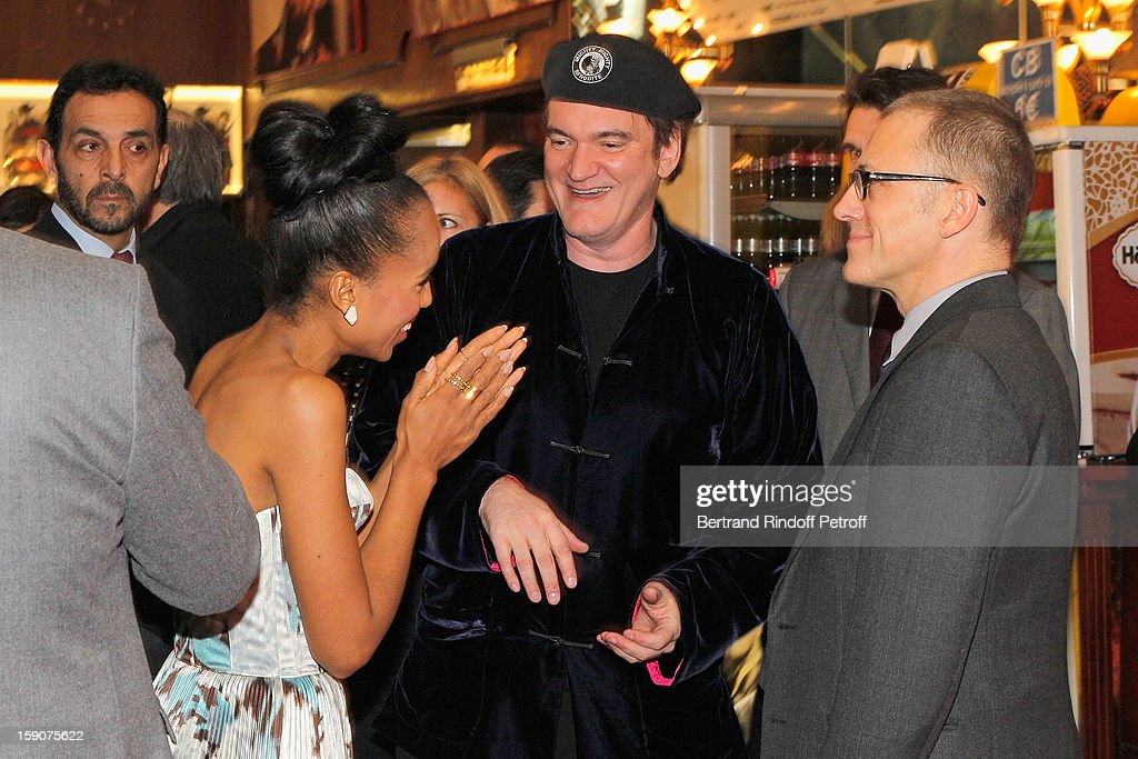 Kerry Washington, Quentin Tarantino and Christoph Waltz share a light moment prior to attending a photocall for 'Django Unchained' at Le Grand Rex on January 7, 2013 in Paris, France.