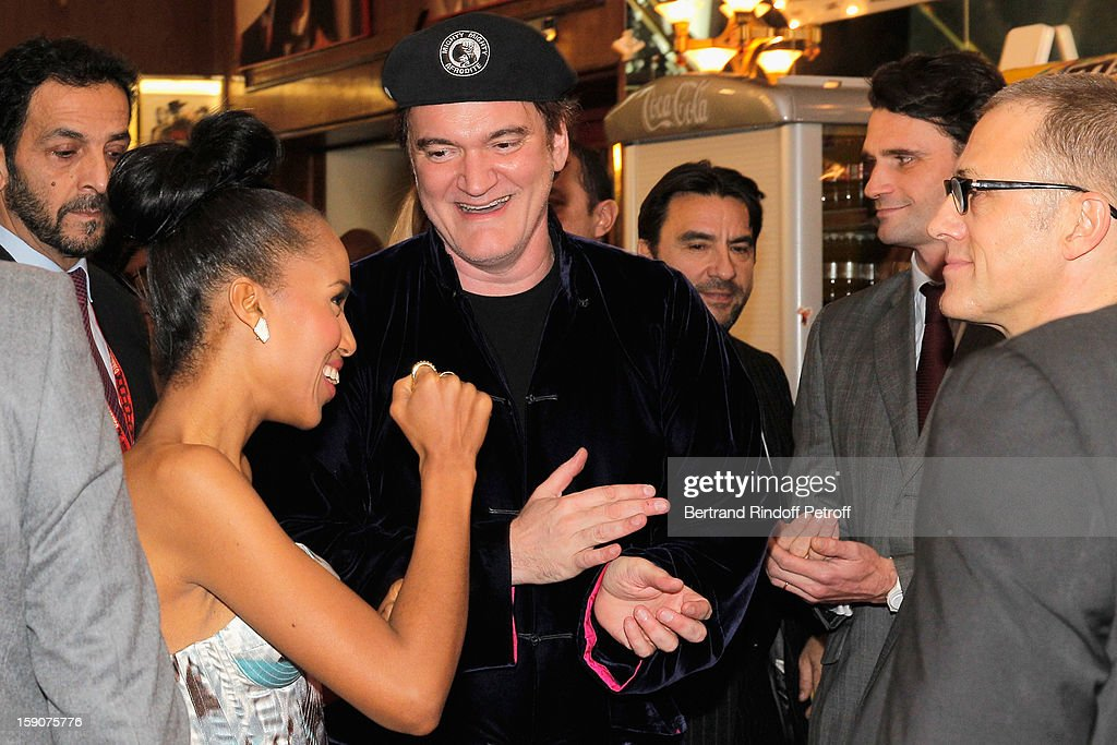Kerry Washington , Quentin Tarantino and Christoph Waltz share a light moment prior to attending a photocall for 'Django Unchained' at Le Grand Rex on January 7, 2013 in Paris, France.
