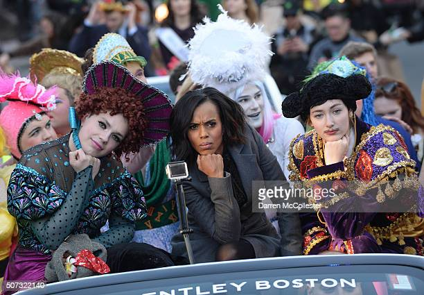 Kerry Washington rides in a parade with cats members Robert Fitzpatrick and David Sheynberg as she is honored by Hasty Pudding Theatrical with the...