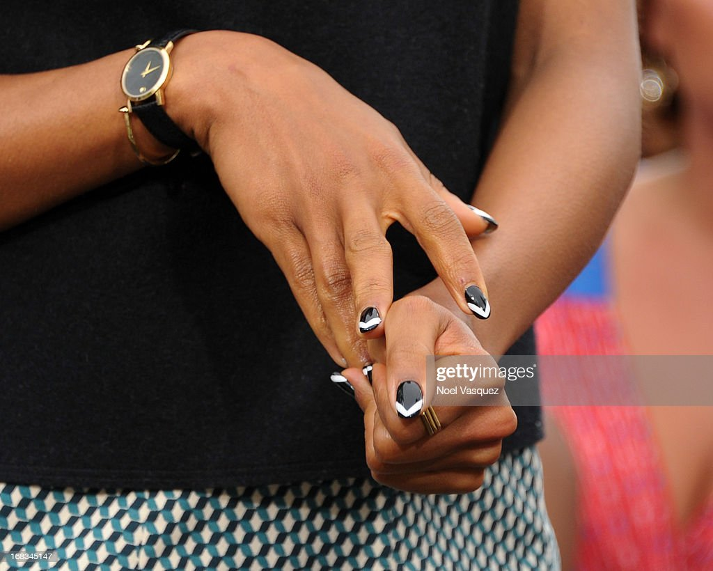 <a gi-track='captionPersonalityLinkClicked' href=/galleries/search?phrase=Kerry+Washington&family=editorial&specificpeople=201534 ng-click='$event.stopPropagation()'>Kerry Washington</a> (nail and jewelry detail) visits 'Extra' at The Grove on May 8, 2013 in Los Angeles, California.