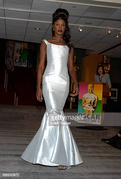 Kerry wears fashion designer Pamella Roland's ice blue mermaid gown with Harry Winston aquamarine drop necklace and solitaire ring with emerald cut...