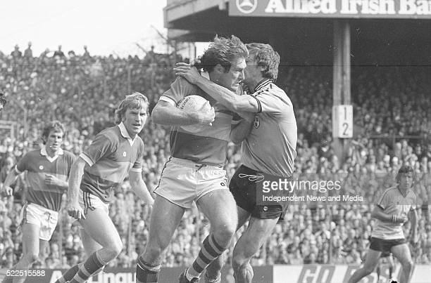 Kerry's John O'Keefe being tackled by Dublin's John McCarthy as Kerry's Mick Splianne Jimmy Deenihan and Dublin's Bobby Doyle await the outcome at...