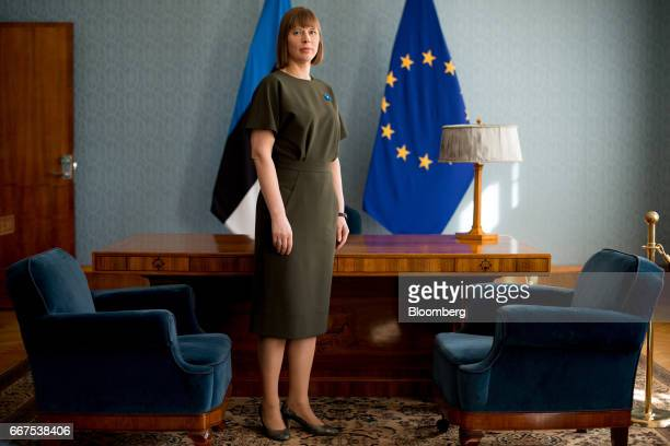 Kersti Kaljulaid Estonia's president poses for a photograph in front of an Estonian left and a European Union flag following an interview at the...