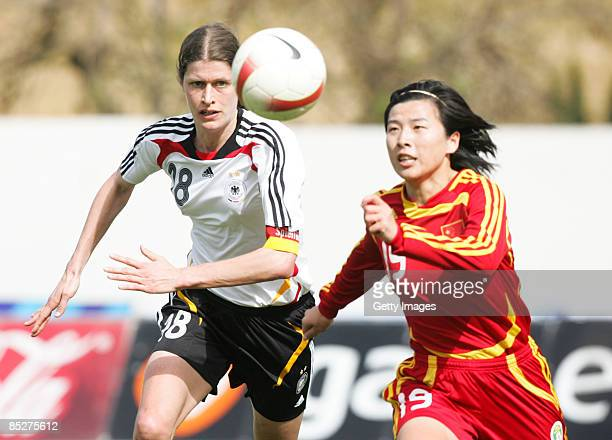 Kerstin Garefrekes and Gao Yan battle for the ball dduring the Women Algarve Cup match between Germany and China at the Municipal stadium on March 6...