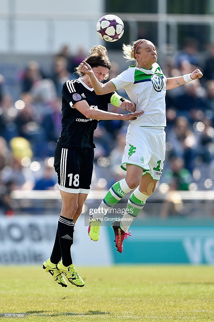 <a gi-track='captionPersonalityLinkClicked' href=/galleries/search?phrase=Kerstin+Garefrekes&family=editorial&specificpeople=236090 ng-click='$event.stopPropagation()'>Kerstin Garefrekes</a> of 1. FFC Frankfurt and <a gi-track='captionPersonalityLinkClicked' href=/galleries/search?phrase=Alexandra+Popp&family=editorial&specificpeople=703429 ng-click='$event.stopPropagation()'>Alexandra Popp</a> of VfL Wolfsburg go up for a header during the UEFA Women's Champions League Semi Final second leg match between 1. FFC Frankfurt and VfL Wolfsburg at Stadion am Brentanobad on May 1, 2016 in Frankfurt am Main, Germany.