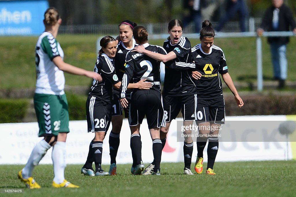 Kerstin Garefrekes of Frankfurt celebrates with teammates after scoring his team's first goal during the Women's DFB Cup semi final match between 1. FFC Frankfurt and FCR Duisburg at Brentanobad Stadium on April 8, 2012 in Frankfurt am Main, Germany.