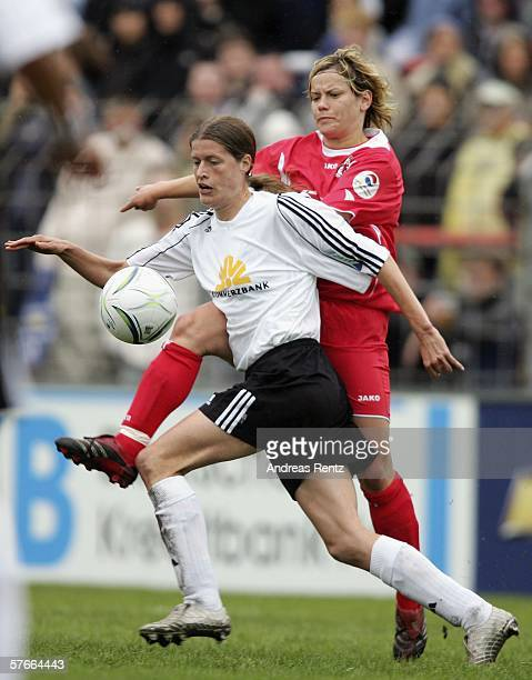 Kerstin Garefrekes of Frankfurt vies for the ball with Jennifer Zietz of Potsdam during the Women's UEFA Cup Final first leg match between FFC...