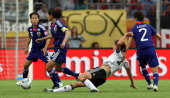 Kerstin Garefrekes of Germany and Homare Sawa of Japan battle for the ball during the FIFA Women's World Cup 2011 Quarter Final match match between...