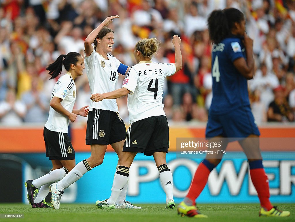 Kerstin Garefrekes of Germany celebrates scoring the opening goal with Babett Peter during the FIFA Women's World Cup 2011 Group A match between France and Germany at Borussia Park on July 5, 2011 in Moenchengladbach, Germany.