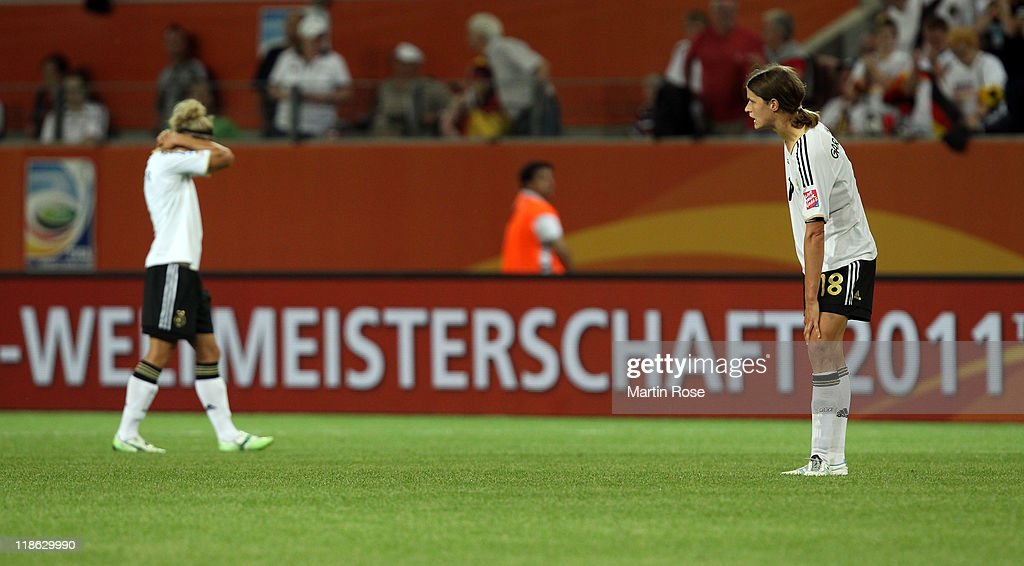 Kerstin Garefrekes (R) of Germany looks dejected after the FIFA Women's World Cup 2011 Quarter Final match match between Germany and Japan at Wolfsburg Arena on July 9, 2011 in Wolfsburg, Germany.