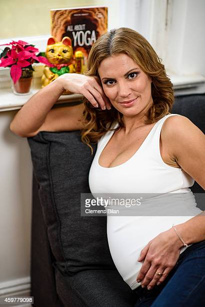 Kerstin Linnartz poses during a portrait session announcing her pregnancy on November 28 2014 in Berlin Germany