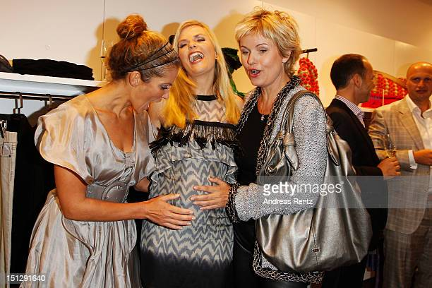 Kerstin Linnartz Tanja Buelter and Carola Ferstl attend the Rohmir Store first birthday party on September 5 2012 in Berlin Germany