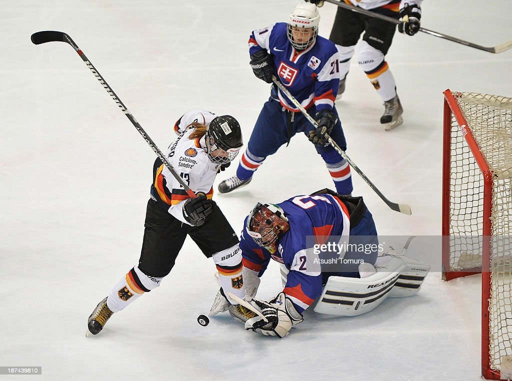 Kerstin Spielberger (L) of Germany and Daniela Zuziakova (R) of Slovakia in action in the match between Slovakia and Germany during day three of the Ice Hockey Women's 5 Nations Tournament at the Shin Yokohama Skate Center on November 9, 2013 in Yokohama, Japan.