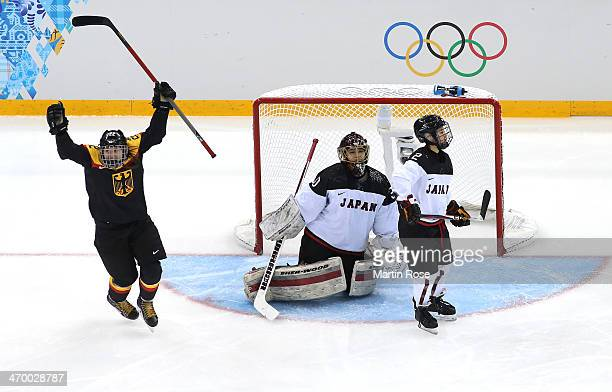 Kerstin Spielberger of Germany celebrates a goal by Julia Zorn in the second period against Nana Fujimoto of Japan during the Women's Classifications...