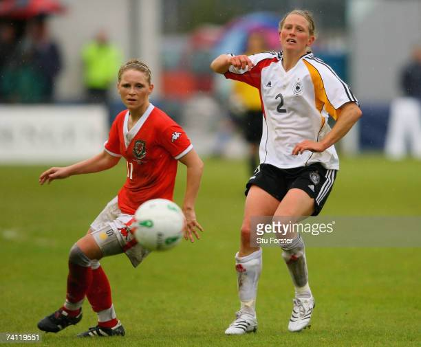 Kerstin Stegemann of Germany is beaten to the ball by Jessica Fishlock of Wales during the UEFA Womens Championship Qualification Round match between...