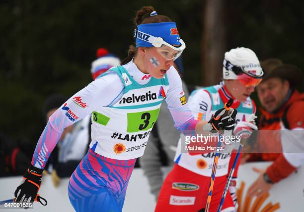 Kerttu Niskanen of Finland and Astrid Uhrenholdt Jacobsen of Norway compete during the Women's Cross Country 4x5km Relay at the FIS Nordic World Ski...