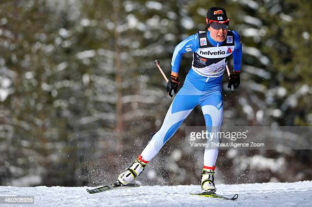 Kerttu Niskanen of Finland competes during the FIS CrossCountry World Cup Tour de Ski Women's Pursuit on January 03 2014 in CortinaToblach Italy