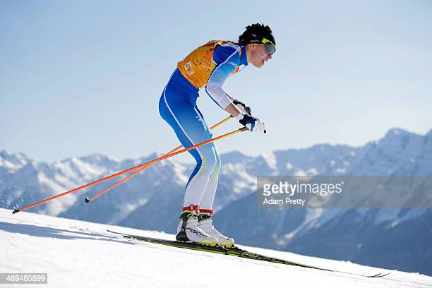 Kerttu Niskanen of Finland competes in the Women's 4 x 5 km Relay during day eight of the Sochi 2014 Winter Olympics at Laura Crosscountry Ski...