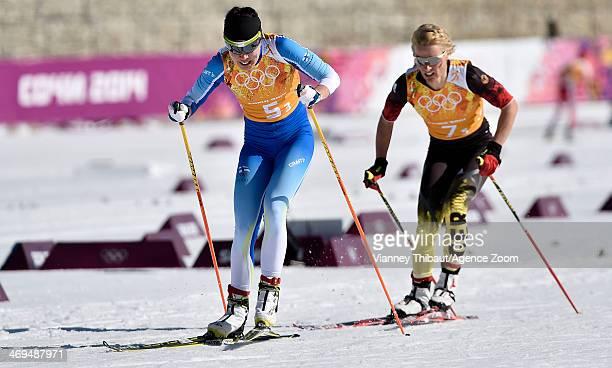 Kerttu Niskanen of Finland wins silver medal Krista Lahteenmaki of Finland wins silver medal during the CrossCountry Women's Relay at the Laura...