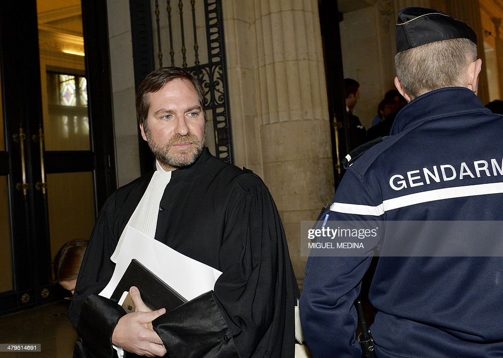 Kerviel's lawyer Patrice Spinosi (L) leaves on March 19, 2014 the Paris'court at the end of the appeal of rogue trader Jerome Kerviel against his sentence of three months in prison and 4,9 billion fine over charges of rogue trading. A top French appeals court today upheld Kerviel's three-year jail sentence over high-risk trading that cost the Societe Generale bank nearly five billion euros ($7 billion). But the court cancelled the 4.9 billion euros in damages that Kerviel was ordered to pay, and referred this part of the ex-trader's sentence to another court near Paris to be re-judged. Kerviel's lawyer Patrice Spinosi had argued in February while appealing the conviction for breach of trust that Societe Generale had committed 'wilful misconduct' and was aware of his client's high-risk trading. AFP PHOTO /MIGUEL MEDINA
