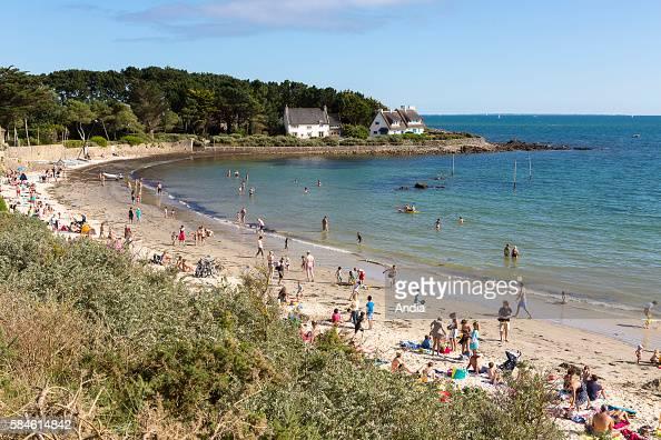 Kervillen beach in La Trinite sur Mer Tourists sunbathing on the sand