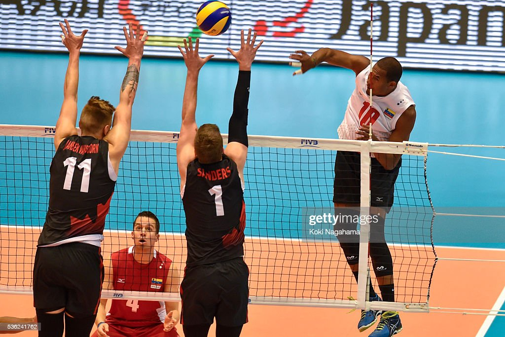 Kervin Martin Pinerua Urbina #10 of Venezuela spikes the ball during the Men's World Olympic Qualification game between Venezuela and Canada at Tokyo Metropolitan Gymnasium on June 1, 2016 in Tokyo, Japan.