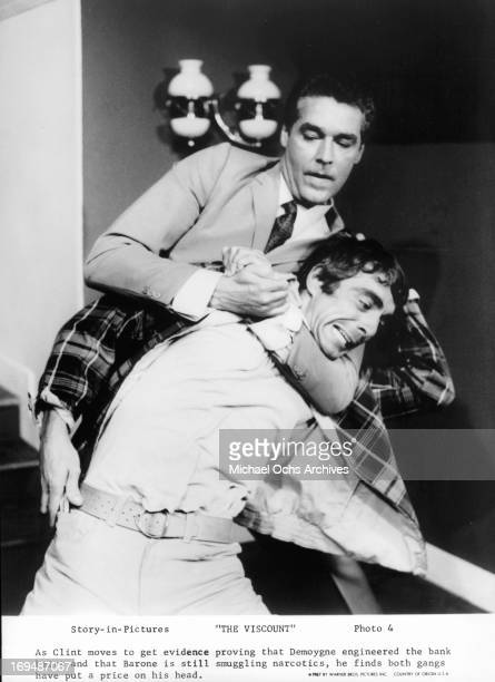 Kerwin Mathews puts a man in a headlock in a scene from the film 'The Viscount' 1967