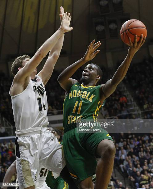 Kerwin Okoro of the Norfolk State Spartans shoots the ball against Ryan Cline of the Purdue Boilermakers at Mackey Arena on December 21 2016 in West...