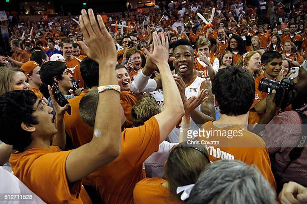Kerwin Roach Jr #12 of the Texas Longhorns celebrates with the fans after the Texas Longhorns defeated the Oklahoma Sooners 7663 at the Frank Erwin...