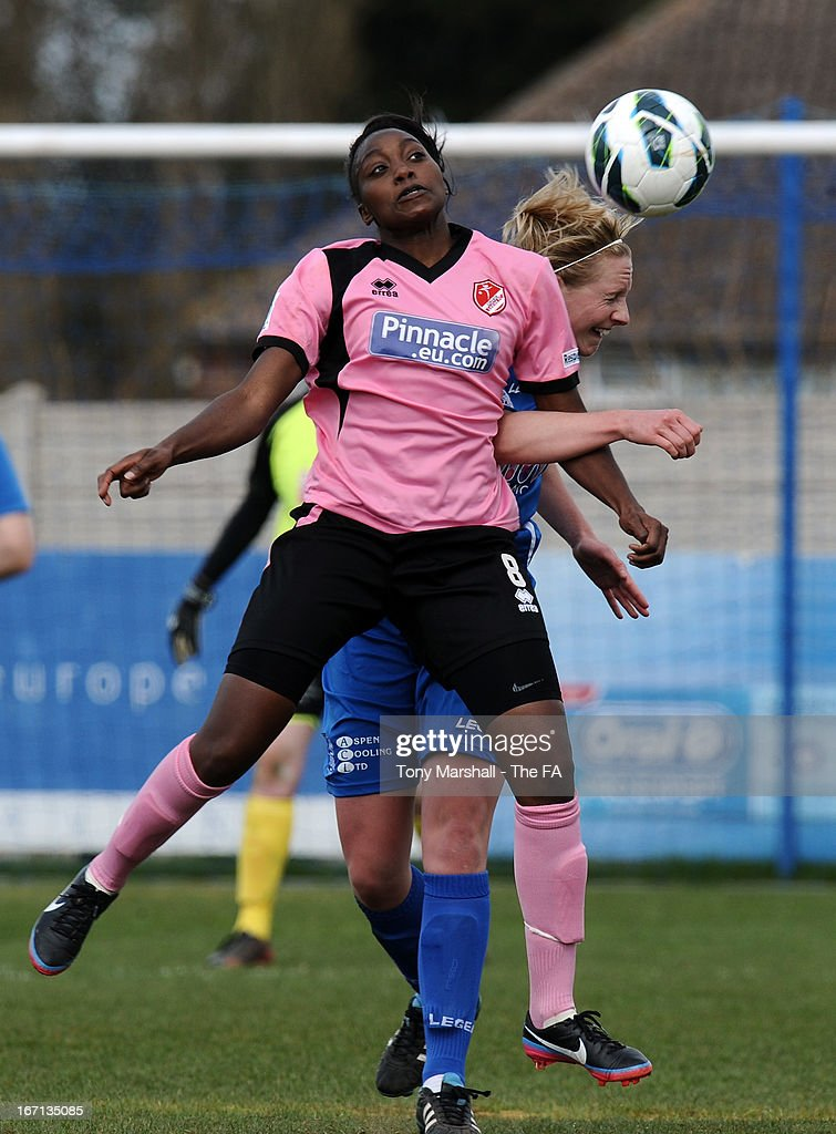 Kerys Harrop of Birmingham City challenges Precious Hamilton of Lincoln Ladies (L) during the FA Women's Super League match between Birmingham City Ladies FC and Lincoln Ladies FC at DCS Stadium, Stratford Town FC on April 21, 2013 in Stratford, England.