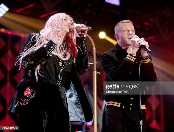 Kesha and Macklemore perform onstage during 1027 KIIS FM's Jingle Ball 2017 presented by Capital One at The Forum on December 1 2017 in Inglewood...